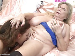 Young lady and a fat granny go down on hot cunt tubes