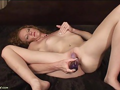 Cute curly hair milf fucks a toy into her hot cunt tubes