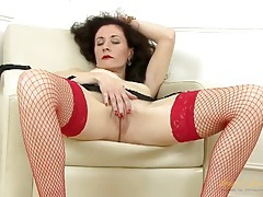Her milf pussy is perfect as the babe plays in fishnets tubes