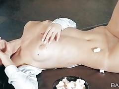 Teen sensually rubs her shaved vagina tubes