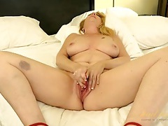 Curvy mom in high heels plays with a new vibrator tubes