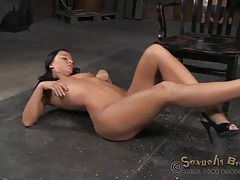 Flexible brunette bound in the dungeon tubes