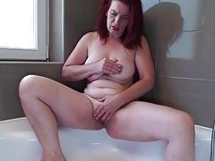 Big booty mature redhead rubs her hot holes tubes