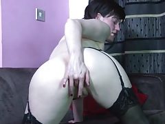 Cute solo milf in stockings rubs her wet cunt tubes