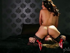 Lesbian beauty on a leash eats out her mistress tubes