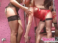 Sultry lesbians in lingerie strip on the pole tubes