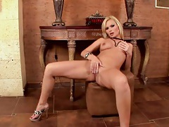 Naked blonde glamour girl fingers her sexy twat tubes