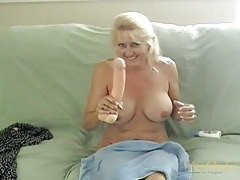 Mature cutie with big round titties fucks her toy tubes