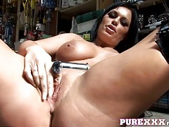Thick babe fucks a car part in the garage tubes