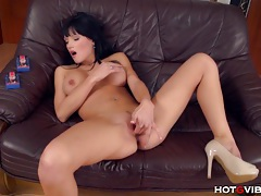 She fingers her wet shaved pussy tubes
