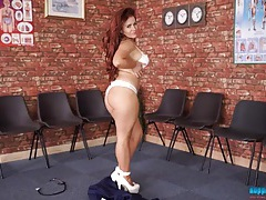 Voluptuous redheaded nurse in a naughty striptease tubes
