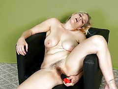 Hairy milf fucks her cunt with a dildo tubes