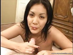 Asian babe jerks off his dick and gives a titjob tubes
