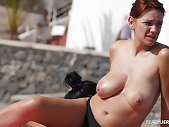 Big natural boobs redhead spied on at the beach tubes