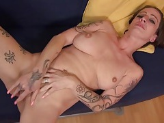 Tattooed old slut with nice tits rubs her snatch tubes