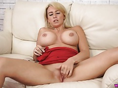 Blonde chick with fake tits rubs her pussy tubes