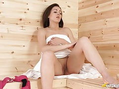 Girl in the sauna shows her shaved pussy tubes
