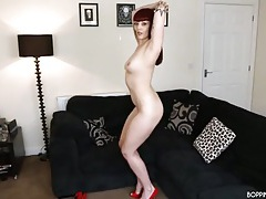 High heeled redhead does an incredible striptease tubes