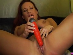 Redhead talks filthy as she fucks a dildo tubes