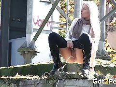 Leggings and boots babe pisses in public tubes
