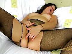 Ripped fishnet pantyhose on this horny older lady tubes