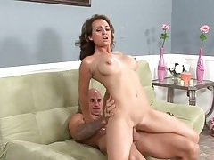 His slutty milf with implants sits on a dick tubes