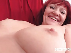 Hot mature redhead rubs her hairy twat tubes