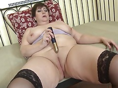 Fat old lady slips a toy into her wet cunt tubes