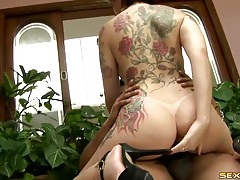 Tattooed brazilian babe sits on a big black cock tubes