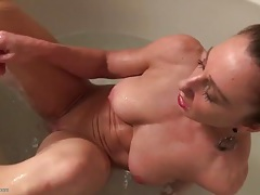 Fit and wet mom masturbating in the bathtub tubes