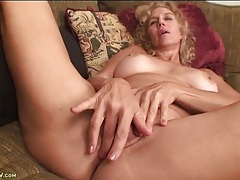 Friendly big tits mature chick plays with her cunt tubes