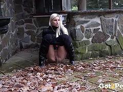 Beautiful blonde girl goes pee outdoors tubes