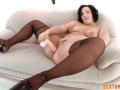 Fat girl fucks a dildo deep into her pink snatch tubes