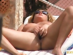 Tanning babe caught masturbating outdoors tubes