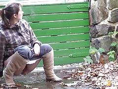 Hairy bush cutie takes a hot piss in public tubes